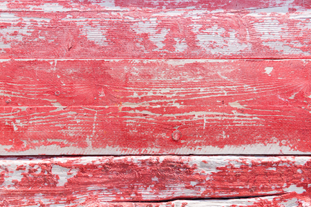 Rough and shabby wood pattern with peeling red paint Stock Photo