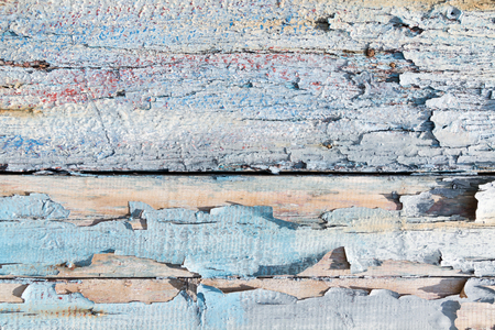 Rough and shabby wood pattern with peeling blue paint