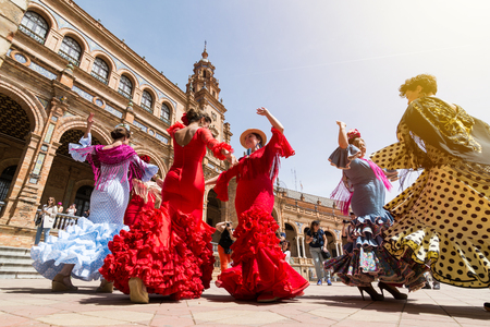 SEVILLE, SPAIN - MAY 2017: Young women dance flamenco on Plaza de Espana
