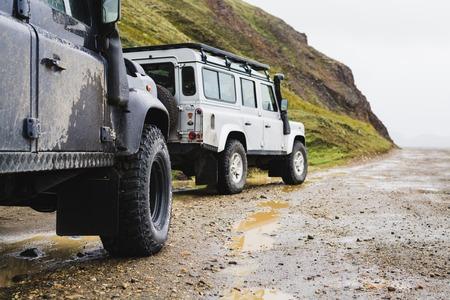 LANDMANNALAUGAR, ICELAND - AUGUST 2018: two offroad cars on the mud terrain.