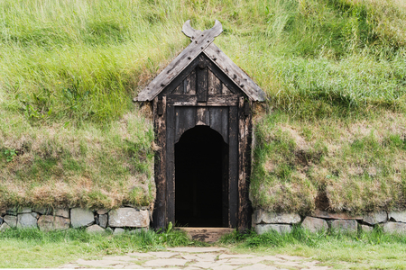 Wooden door entrance to the Icelanding historical turf house Stock Photo