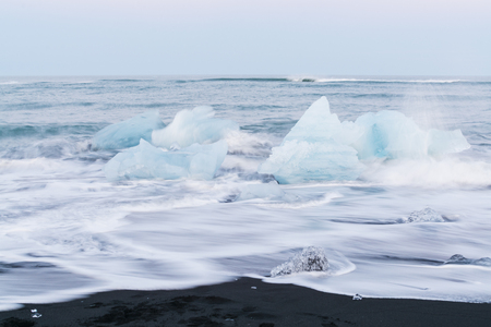 Icebergs floating and melting in arctic ocean. Pieces of ice drifted out of Jokulsarlon lagoon, Iceland.
