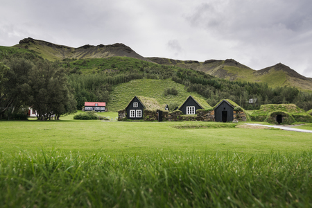 SKOGAR, ICELAND - AUGUST 2018: Traditional Icelandic turf houses with grass roof in Skogar open air museum, Iceland.
