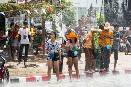 SUKHOTHAI, THAILAND - 13 APRIL 2019: Thai people celebrating New Year Songkran Water Festival on the street. Editorial