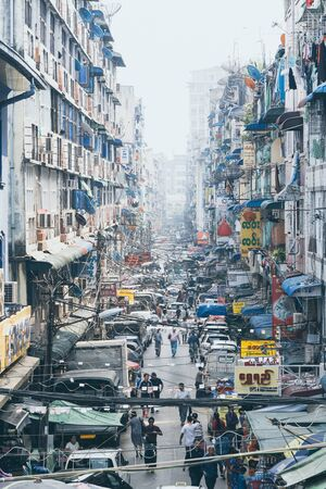 Yangon, Myanmar - March 2019: street view in the old town district. Vertical orientation. Editorial