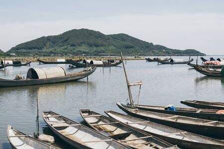 Traditional Vietnamese fishing boats with oval roofs, Vietnam