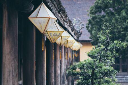 Traditional paper lanterns of Hue city getting wet under heavy monsoon rain in Vietnam.
