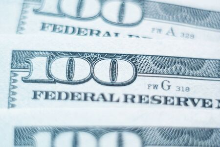 Washington, United States of America - November 2019: Macro closeup of American Federal Reserve banknote with one hundred dollars number in focus