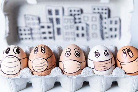 Diverse chicken eggs with doodle faces wearing medical masks with a city skyline on the background. Conceptual image of pollution and epidemy