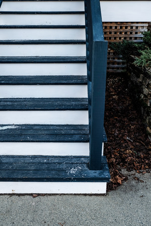 corner house: white navy blue stair in front of house