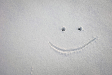 drow: we drow the smile on the snow ground in the cloudy day Stock Photo