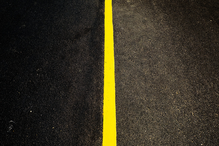 yellow line: the road with single yellow line in center Stock Photo