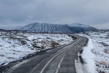 Snow vocalno beautiful background with long route cover with snow in north iceland