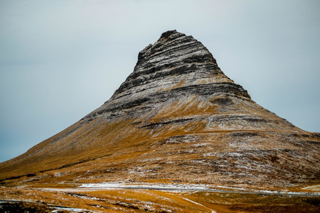 close up kirkjufell mountain in iceland with grey sky bad weather day mountain background in west of iceland