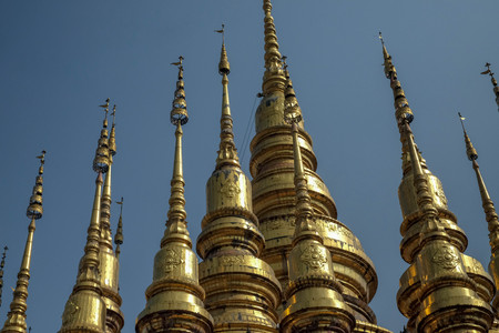 beautiful gold color pagoda in temple North Thailand Stock Photo