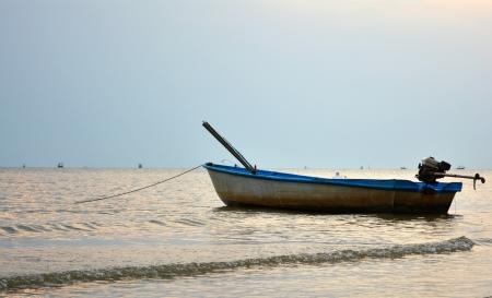 Boat drifting in ocean close to shore