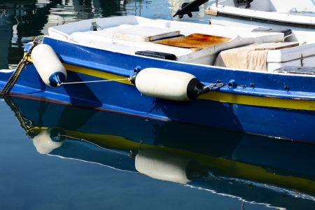 historical reflections:  blue fishing boat with relection