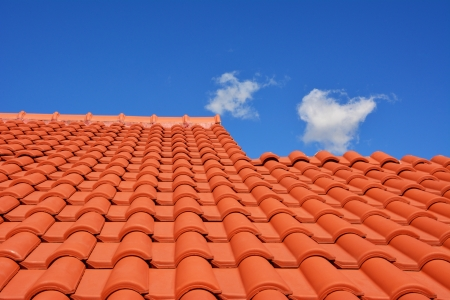red roof texture tile and blue sky with cloud