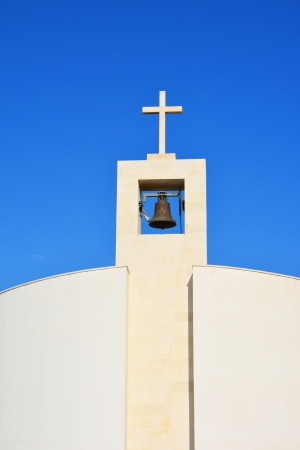 Small modern church tower  with bell in Split, Croatia