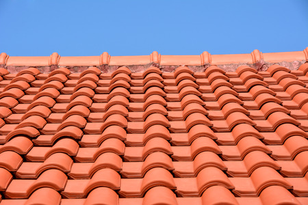 red roof texture tile and blue sky in background