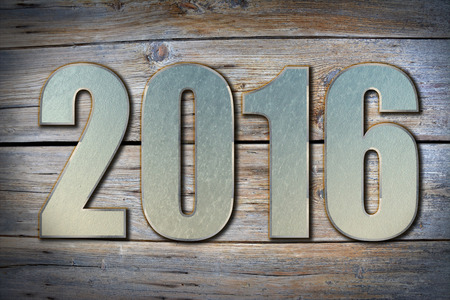 turns of the year: 2016 steel numbers on old grunge wooden background