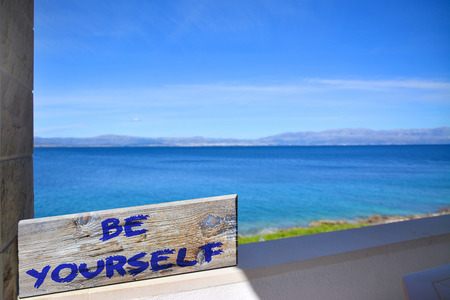 happenings: Be yourself on old plank with blurred sea background