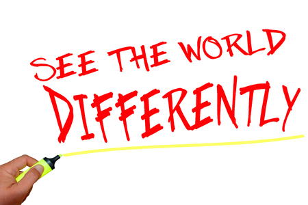 differently: See the world differently text with marker on white background Stock Photo