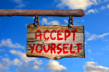 happenings: Accept yourself sign on old wood with a blurred sky on background