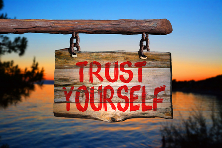 yourself: Trust yourself sign on blurred background Stock Photo