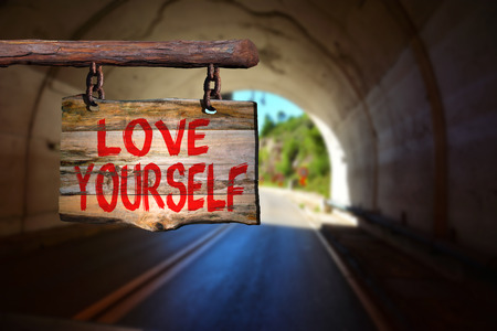 yourself: Love yourself sign with tunnel blurred background