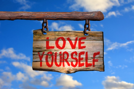 happenings: Love yourself sign with sky blurred background