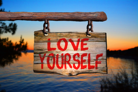 yourself: Love yourself sign with sunset blurred background