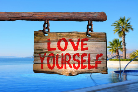yourself: Love yourself sign with tropic blurred background