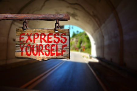 happenings: Express yourself sign with tunnel blurred background Stock Photo