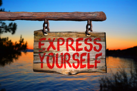 be the change: Express yourself sign with sunset blurred background Stock Photo