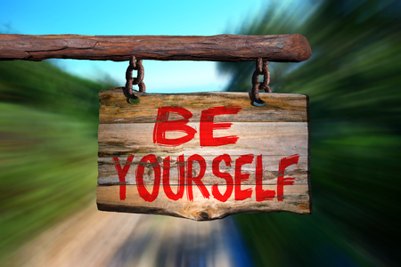 happenings: Be yourself sign with speedy road blurred background Stock Photo