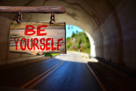 happenings: Be yourself sign with tunnel blurred background