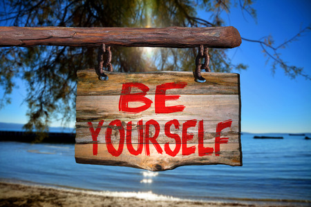 happenings: Be yourself sign with beach blurred background