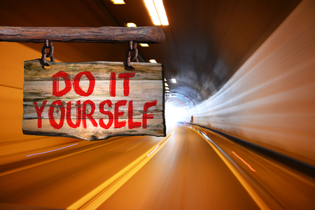 do it yourself: Do it yourself sign with blurred background Stock Photo