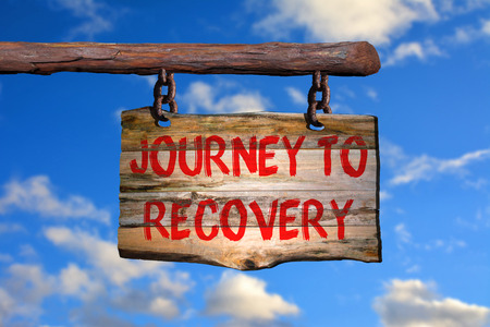 recovery: Journey to recovery sign with blurred background