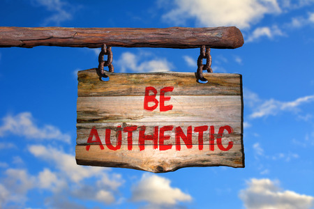 faked: Be authentic sign with blurred background