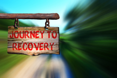 work addicted: Journey to recovery sign with blurred background