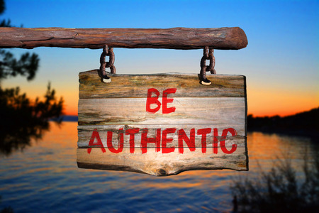 Be authentic sign with blurred background