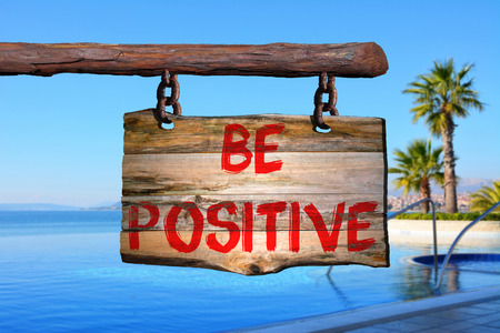 be the change: Be positive sign with blurred background
