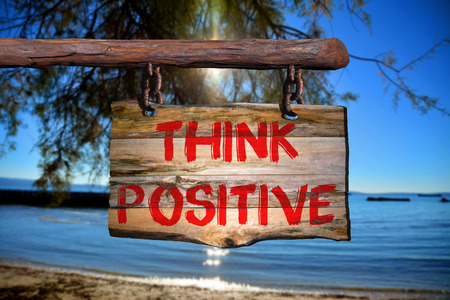 spiritual energy: Think positive sign with blurred background