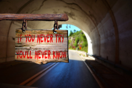 newer: If you newer try, youll never know motivational phrase sign on old wood with blurred background