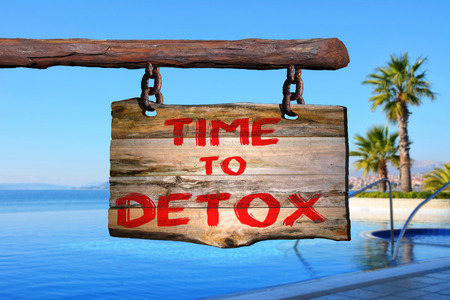 detoxing: Time to detox motivational phrase sign on old wood with blurred background