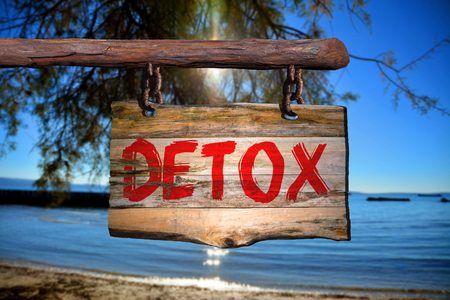detoxing: Detox motivational phrase sign on old wood with blurred background