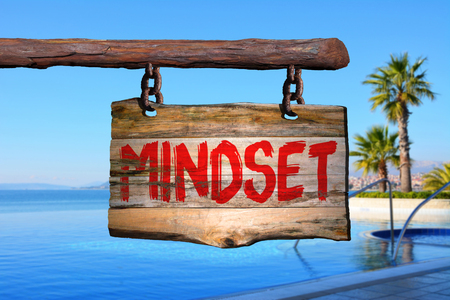 phrase: Mindset motivational phrase sign on old wood with blurred background