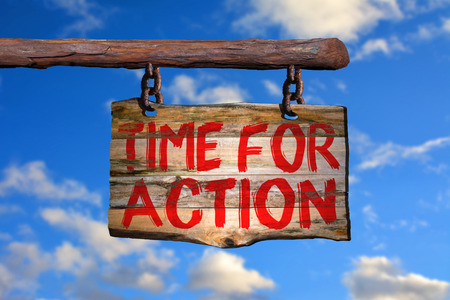 Time for action motivational phrase sign on old wood with blurred background